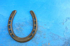 Horseshoes. On blue textured canvas Royalty Free Stock Photos