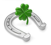 Horseshoes and clover with four leaf Stock Image