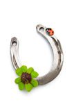 Horseshoes and clover with four leaf Royalty Free Stock Photo