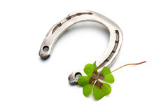 Horseshoes and clover with four leaf Royalty Free Stock Images