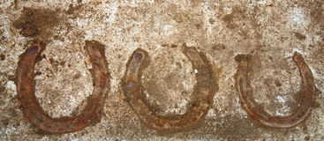 Horseshoes in Concrete Stock Photography