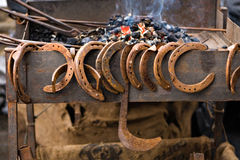 Horseshoes and forge Royalty Free Stock Images
