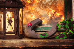 Horseshoes and four-leaf clover on New Year's Eve Stock Photography