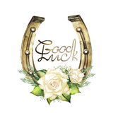 Horseshoes in golden color with white roses Royalty Free Stock Photo