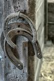 Horseshoes hanging in a stall in a barn royalty free stock photos