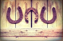Horseshoes on the wall Stock Image