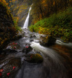 Horsetail Falls with autumn foliage stock photo