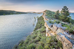 Horsetooth Reservoir at springtime. Sandstone cliff and lake at dusk - Horsetooth Reservoir near Fort Collins, Colorado, at springtime Royalty Free Stock Image
