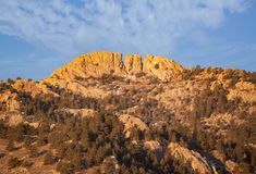 Horsetooth rock formation at sunrise is a distinctive geological and popular mountain landmark overlooking Fort Collins,Colorado. Horsetooth rock formation at royalty free stock photo