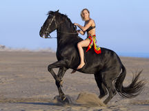 Horsewoman on the beach Stock Photo