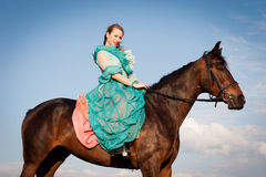 Horsewoman and blue sky Royalty Free Stock Photo