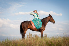 Horsewoman and blue sky Stock Images