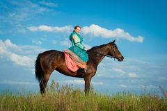 Horsewoman and blue sky Stock Photography