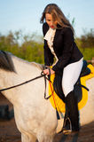 Horsewoman at hippodrome and blue sky Stock Photos