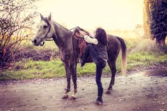 Horsewoman with his horse in the countryside Royalty Free Stock Photos