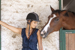 Horsewoman with his horses Royalty Free Stock Photos