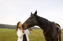 Horsewoman and horse. Royalty Free Stock Image