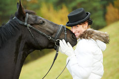 Horsewoman jockey in uniform with horse Royalty Free Stock Photo