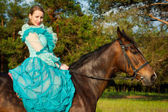 Horsewoman riding. Stock Photo