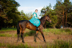 Horsewoman riding. Royalty Free Stock Image