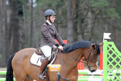 Horsewoman in show jumping Stock Images