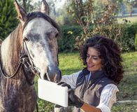 Horsewoman takes a selfie with his horse Royalty Free Stock Photos