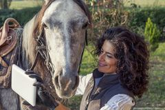 Horsewoman takes a selfie with his horse Stock Photos