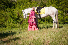 Horsewoman and white horse Royalty Free Stock Image