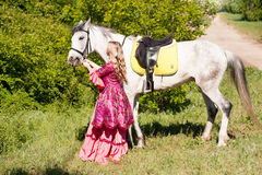 Horsewoman and white horse Stock Image