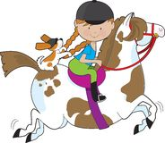 Horsey Holly. A little girl riding a painted pony with a Cavalier King Charles Spaniel sitting behind her and holding on to her braids Royalty Free Stock Photos