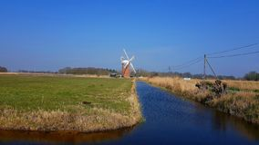 Horsey windmill   near the Mere is one of the Norfolk Broads in the east of England. Horsey windmill mere one norfolk broads east england more northerly close stock image