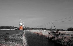 Horsey windmill   near the Mere is one of the Norfolk Broads in the east of England. Horsey windmill mere one norfolk broads east england more northerly close royalty free stock image
