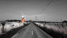 Horsey windmill   near the Mere is one of the Norfolk Broads in the east of England. Horsey windmill mere one norfolk broads east england more northerly close stock photos
