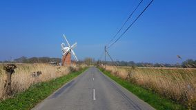 Horsey Windmill  near the Mere is one of the Norfolk Broads in the east of England. Horsey windmill near the horsey  mere one norfolk broads east england more royalty free stock photography
