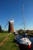 Horsey Wind pump. Horsey Windpump, with pleasure boats, on the Norfolk broads, UK Stock Images