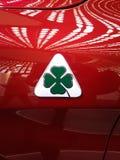 Horspower 500 rouge de Giulia d'alpha de signe de trèfle à quatre feuilles photos libres de droits