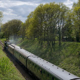 HORSTED KEYNES, SUSSEX/UK - APRIL 13 : Flying Scotsman on the Bl. Uebell Line near Horsted Keynes in Sussex on April 13, 2017. Unidentified people royalty free stock image