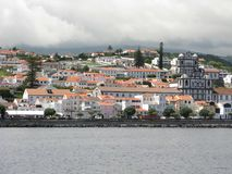 Horta town seen from the ocean, Faial island, The Azores. View of the white buildings of Horta town from the ocean on Faial island, The Azores royalty free stock photography