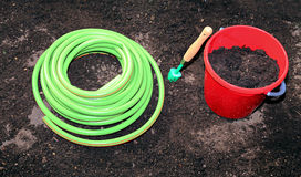 Horticulture accessories on the gardenbed. In the garden stock image
