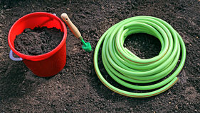 Horticulture accessories on the gardenbed Royalty Free Stock Image