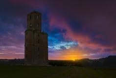 Horton Tower en galenskap i östliga Dorset på solnedgången arkivbild