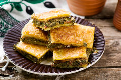 Hortopita. the Greek snack pie with a swiss chard  and feta. Style rustic selective focus Stock Image