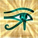 Horus eye glowing on papyrus. Sun rays royalty free stock image