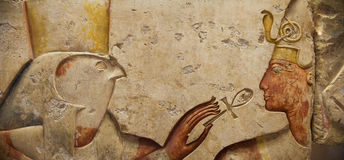 Horus and the Pharaoh. Egyptian stone carving: Horus and the Pharaoh stock images