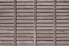 Horyzontalna tekstura ściana od kilka rzędów brown stare drewniane deski Malująca drewniana ściana w brown colo Zdjęcia Royalty Free