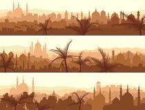 Horyzontalni sztandary duży arabski miasto przy zmierzchem. Obrazy Royalty Free
