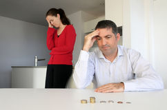 Hosband and wife having financial problems. Hosband and wife age 30-40 having financial problems. Money concept.  Real people. Copy space Stock Photo