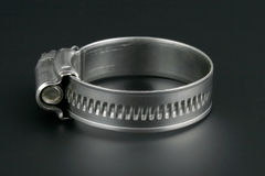 Hose clamp. On the black background royalty free stock photo