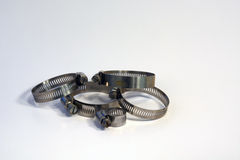 Hose clamps. Adjustable hose clamps for attaching hoses stock photo
