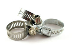 Hose clamps. Three hose clamps with white background. Closeup royalty free stock photos